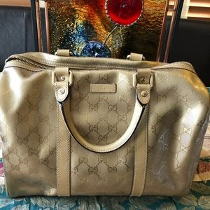 Luscious gold Gucci bag perfect condition